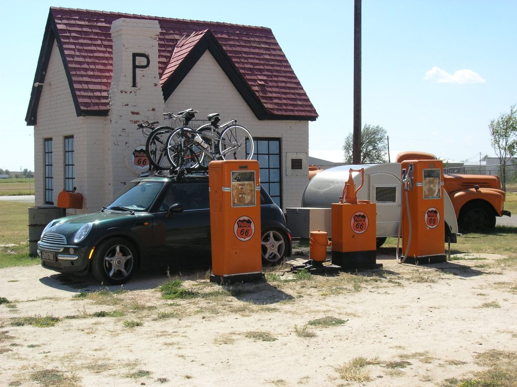 MINI Cooper with Teardrop trailer at a classic Route 66 Phillips 66 gas station.
